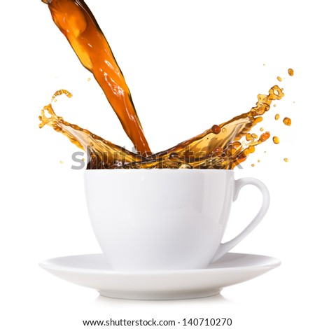 hot coffee is splashing in cup - stock photo