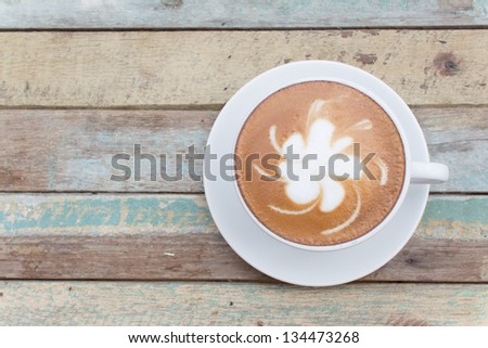 Hot coffee latte cup on grunge background - stock photo