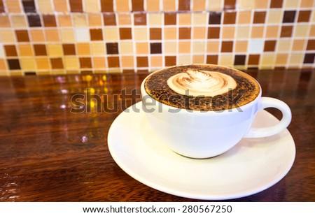 hot coffee mocha latte in white mug  on wood background at  coffee cafe - stock photo