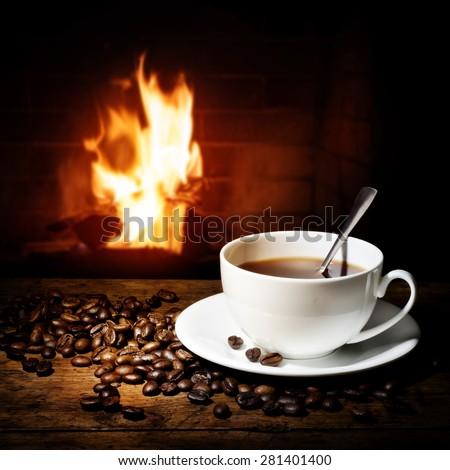 hot coffee near fireplace - stock photo