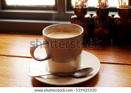 Hot coffee on a wooden table