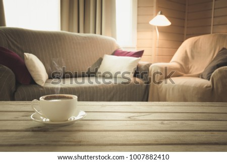 Hot Coffee On Tabletop In Modern Living Room In Rustic Style With Chair,  Soft Divan