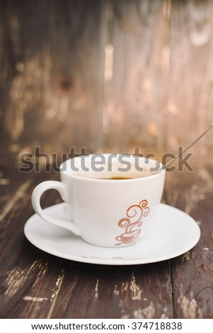 Hot coffee white cup on wood background
