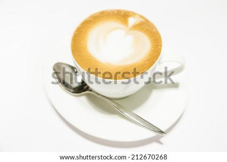 hot coffee with beautiful art on it - stock photo