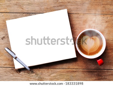 Hot coffee with blank paper note on wood background - stock photo