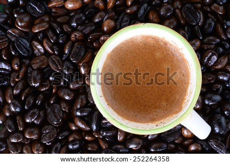 Hot coffee with coffee seed background, beverages - stock photo