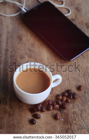 hot coffee with smart phone