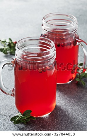 Hot cowberry drink in jars