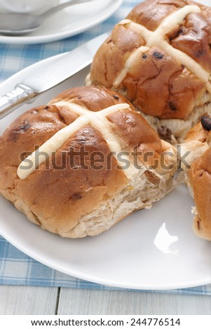 Hot Cross Buns traditionally eaten hot or toasted during Lent - stock photo