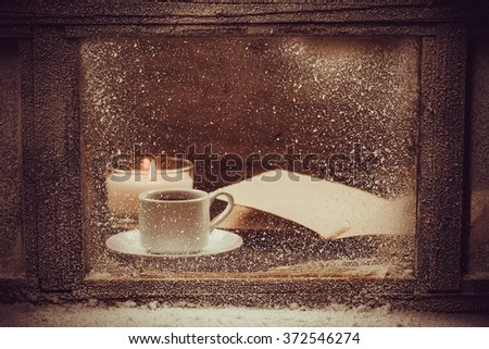Hot Cup of coffee for the frozen winter window. - stock photo