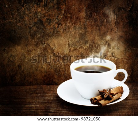 Hot Cup of Coffee in White Mug with Cinnamon and Star Anise in Grunge - Vintage Style