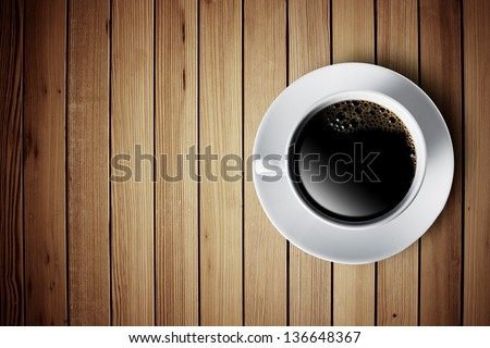 Hot cup of coffee on wood table