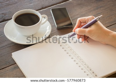 Hot cup of coffee on working table, stock photo