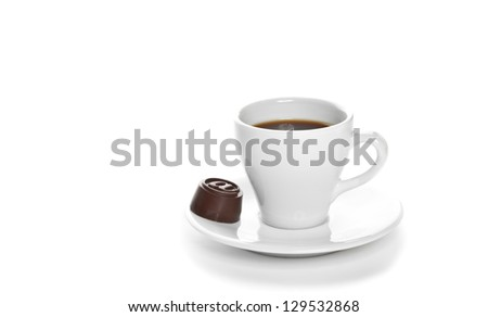 Hot cup of coffee with candy isolated on white
