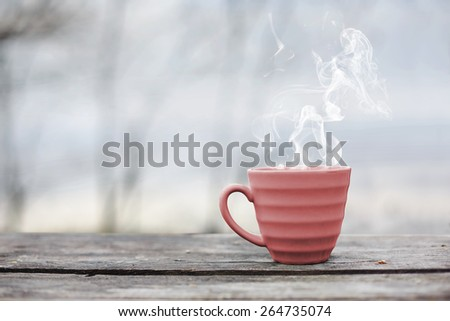 hot cup of tea and early spring background - stock photo