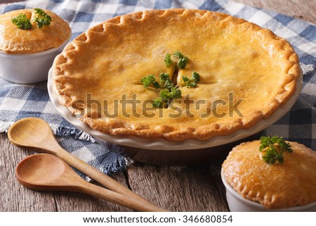 Hot delicious Chicken pot pie in the baking dish close up on the table. Horizontal - stock photo