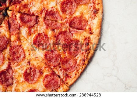 Hot Delicious Pepperoni Pizza Homemade Food Top View - stock photo