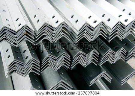 Hot-dip galvanized steel angles bunch on the rack in warehouse before shipment - stock photo