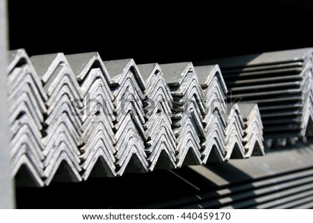 Hot-dip Galvanized Steel member for Steel tower in Transmission line bunch on the rack in warehouse before shipment  - stock photo