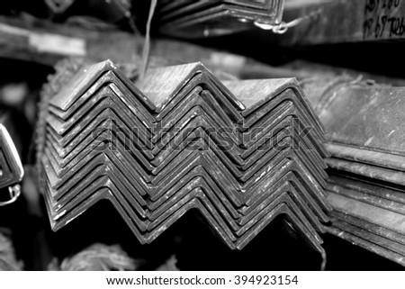 Hot-dip galvanized steel member of structure bunch on the rack in warehouse - stock photo