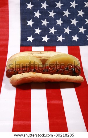 Hot Dog! A pipping hot Hot Dog in a bun with Pineapple Slices on an american flag. The perfect image for all your Hot Dog photo needs. - stock photo