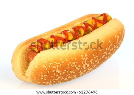 hot dog against white background with onions, pickles,ketchup and mustard on top