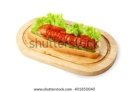 Hot dog. American fast food restaurant cuisine - hotdog with mustard, mayonnaise and ketchup with lettuce at wooden desk on the table. Tasty hotdog at wood isolated at white background - stock photo