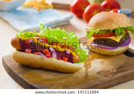 hot dog and bacon served with mustard tomatoes and plenty of backgrounds  - stock photo