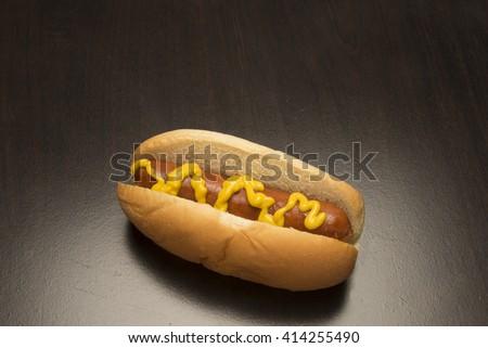 Hot dog and bun/Hot Dog/Delicious red hot dog on a bun  - stock photo