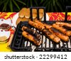 hot dog wieners cooking on an outdoor bar-b-que grill - stock photo