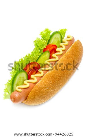 hot dog with cucumbers, tomatoes, lettuce, and mustard on top isolated on white - stock photo