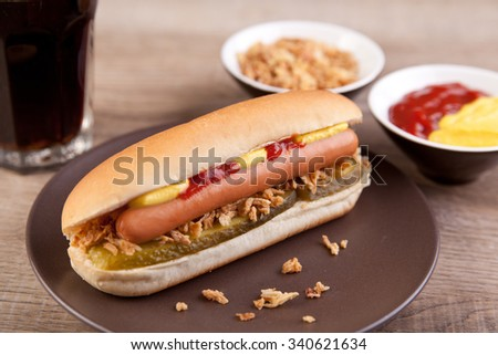 Hot dog with glass of cola - stock photo
