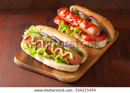 hot dog with ketchup mustard and vegetables - stock photo