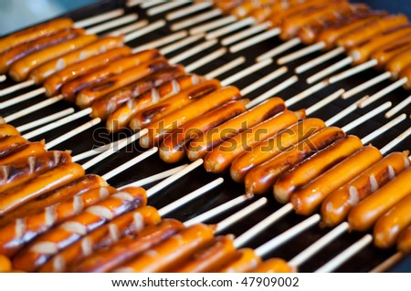 Hot dogs for sale at a Japanese festival.