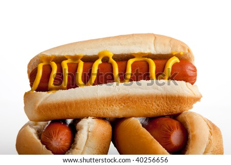 Hot dogs on a bun with mustard on a white background - stock photo