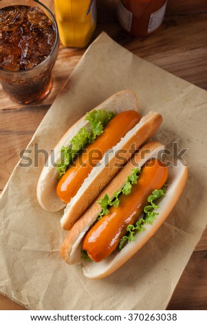 hot dogs on paper for lunch - stock photo