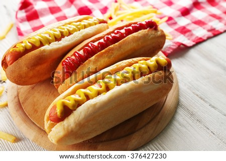 Hot dogs with fried potatoes closeup - stock photo