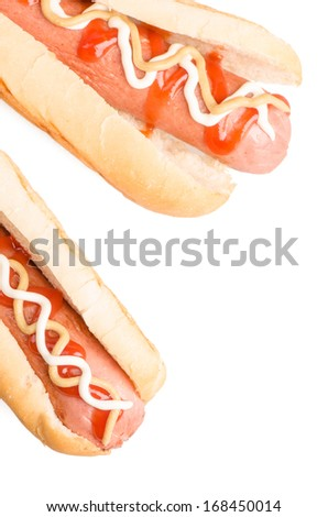 Hot dogs with mustard and ketchup isolated on white background