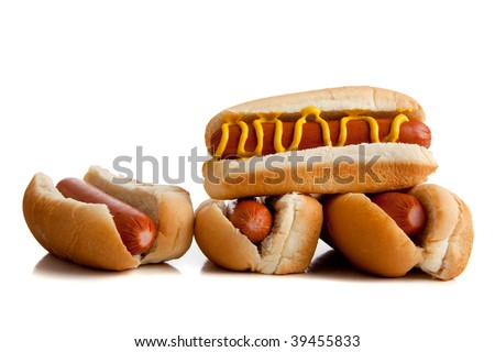 Hot dogs with mustard on buns on a white background - stock photo