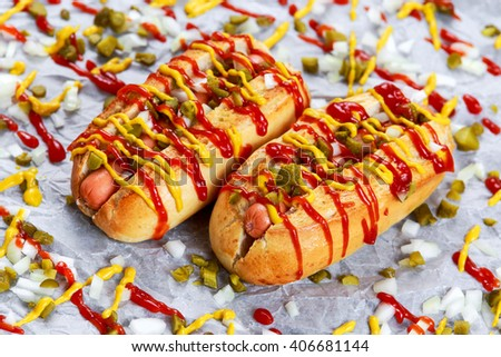 Hot Dogs with sausage, onion, pickles mustard and ketchup.  - stock photo