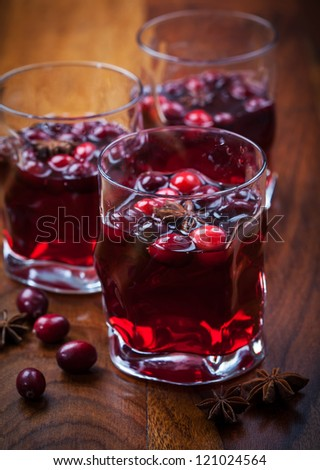 Hot drink with cranberries for Christmas on wooden table - stock photo