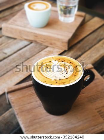 hot espresso on rustic wood - stock photo
