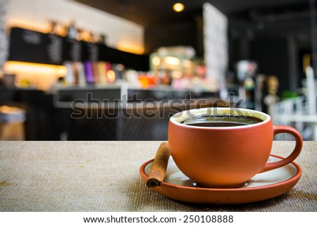 Hot espresso on the table with coffee shop background  - stock photo