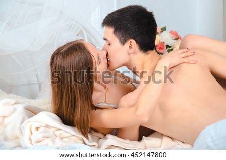 Hot excited Couple of lovers in bed kissing
