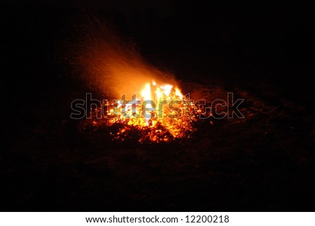 hot fire/bonfire with dancing flames and many sparks