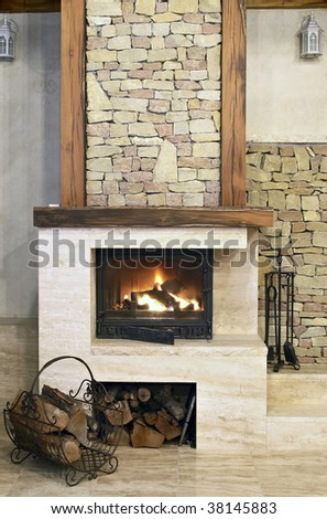 Hot fire in chimney in a room - stock photo