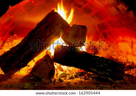Hot fire in oven - stock photo