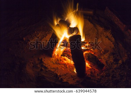 Hot fireplace full of wood and fire burning