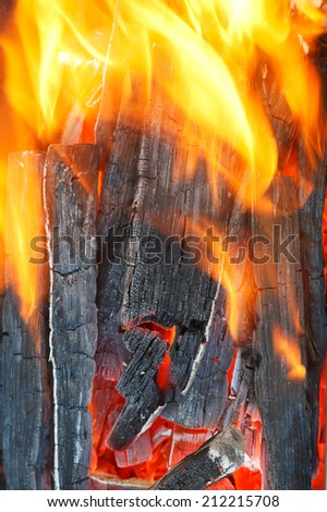 hot flame over burning firewood close up - stock photo