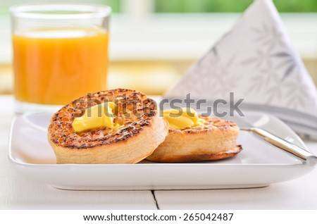 Hot fresh breakfast crumpets with butter melting on top